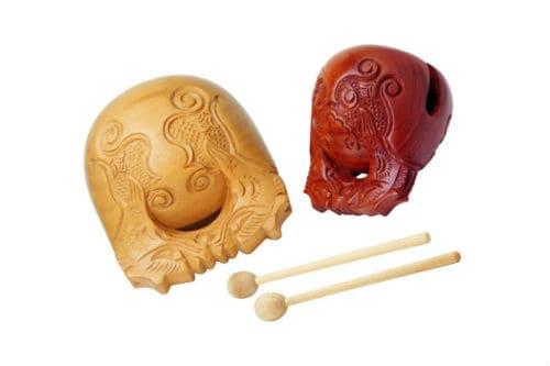 Музыкальный инструмент деревянная рыба